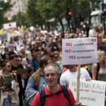 Tens of thousands of anti-lockdown protesters march on London in biggest demo yet.