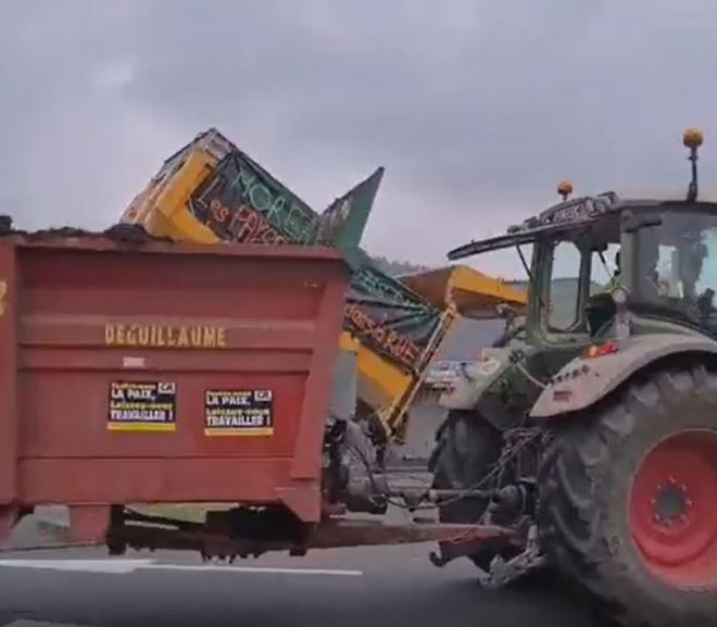 French farmers angered by the rising fuel prices drop manure in front of a government taxation center, gas stations and other government buildings.